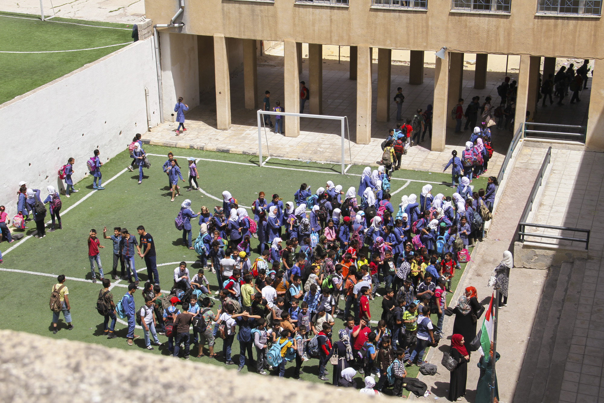 After the welcoming ritual, the students enter the school lined up by class, one after another in a disciplined manner.