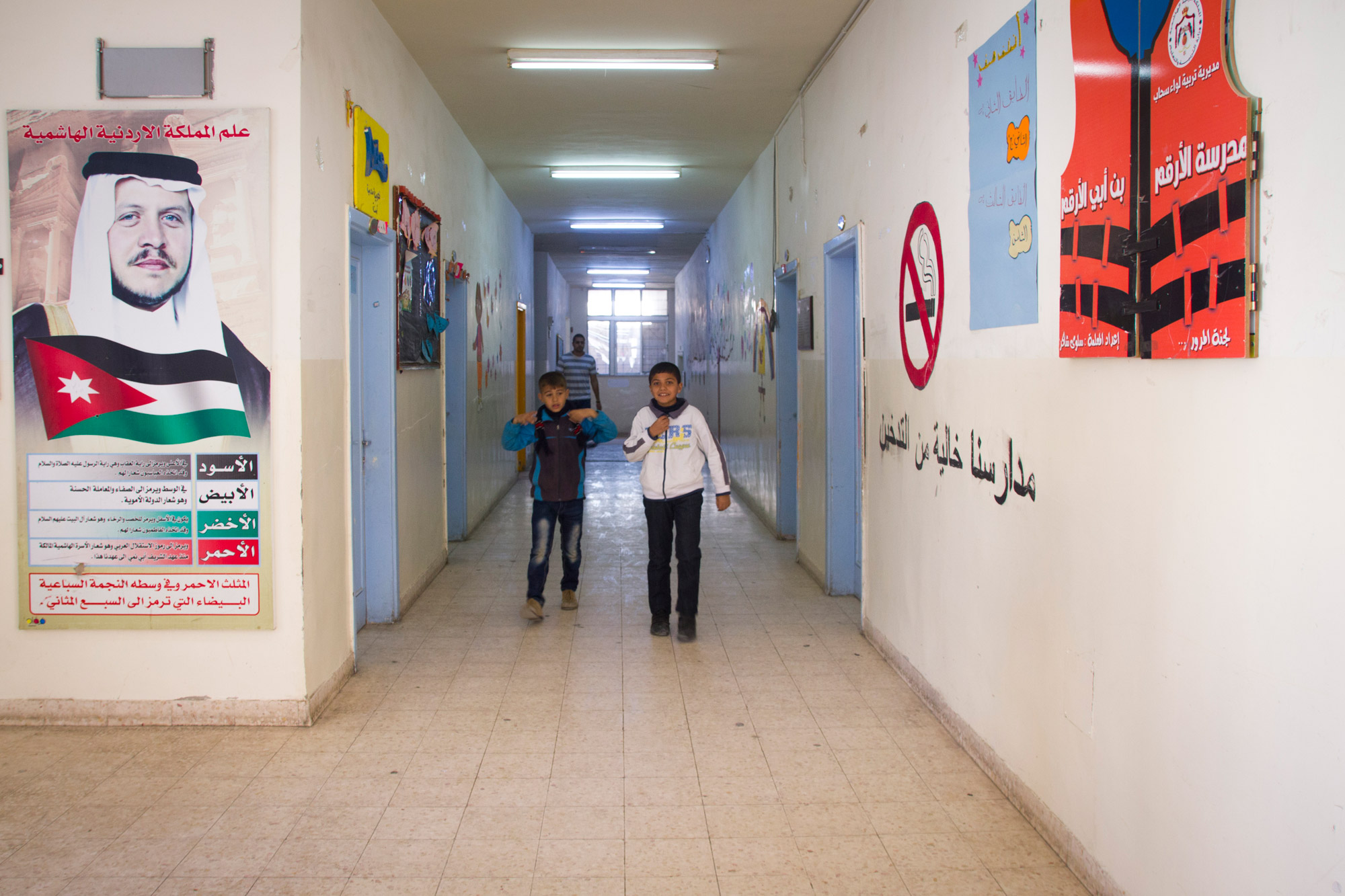 The King of Jordan is omnipresent at this school: a portrait of him is hanging on the hall wall at the entrance.
