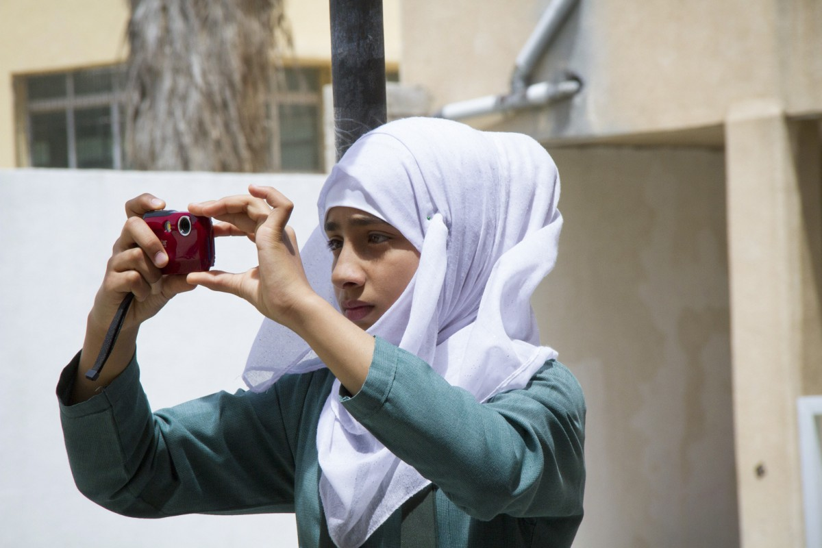 The Syrian 7th grader Maryam takes pictures of her daily routine. Each of the students take the task very seriously.